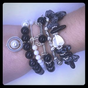Jewelry - Black and silver stacking bracelets.